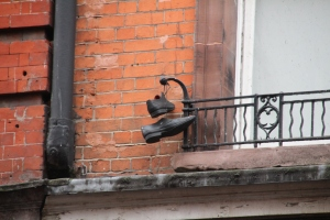 Shoes hanging outside a window in Soho